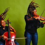 Monique Ross plays the cello and Chauntee Ross plays the violin.