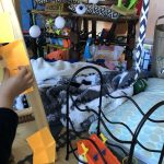 Image of the inside of a child's fort with jumbled blankets, toys, and post-it notes