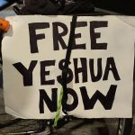 Crowd demonstrates Tuesday to free arrested organizer
