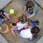 Picture of four children playing ina sandbox