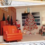 Retro photograph of a living room interior with orange chair and silver Christmas Tree.