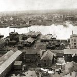 Black and white elevated view of industrial waterfront and the Fox River