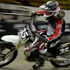image of a girl in motion on a flat track racing bike bearing the number 35
