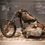 picture of a rusty old Harley Davidson motorcycle on display at the Harley Davidson Museum in Milwaukee